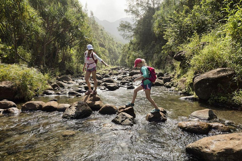 """<p>With summer camps and vacations on hold, a great summer activity for kids is to hit the trail for a hike. <a href=""""https://www.alltrails.com/mobile"""" rel=""""nofollow noopener"""" target=""""_blank"""" data-ylk=""""slk:AllTrails"""" class=""""link rapid-noclick-resp"""">AllTrails</a>, an outdoor recreation app, helps users find and navigate trails and parks, making getting outside easier and more accessible. Users can filter to find trails that are suitable for their needs, like kid-friendly or dog-friendly. The app has also added several features to help users maintain social distancing. """"We all know that it's important for kids to get outside and play,"""" says Dr. Suzanne-Bartlett Hackenmiller, an integrative medicine physician and medical advisor for AllTrails. """"Not only is it vital to our children's physical, mental, and emotional health, but it promotes creativity, and teaches valuable social skills.""""<br></p><p>Natalie Lloyd, a parenting blogger at <a href=""""https://milkweedandmesses.com/"""" rel=""""nofollow noopener"""" target=""""_blank"""" data-ylk=""""slk:Milkweed & Messes"""" class=""""link rapid-noclick-resp"""">Milkweed & Messes</a>, believes that one of the best ways to keep kids occupied during summer vacation is to get outside with them. """"Encouraging kids to explore their surroundings will allow them to work through any boredom while also getting the body and brain moving in ways that kids so desperately need,"""" she says. """"Together, parents and children can learn about bugs, butterflies, plants, and more. Even when families are just walking and talking together, the bonding time is so helpful."""" Once you're outside for the day, don't forget to set up a family picnic. You can keep it simple with a brown bag lunch, or take some inspiration from these <a href=""""https://www.countryliving.com/food-drinks/g783/picnic-recipes-0609/"""" rel=""""nofollow noopener"""" target=""""_blank"""" data-ylk=""""slk:94 delightful picnic food ideas"""" class=""""link rapid-noclick-resp"""">94 delightful picnic food ideas</a>.</p>"""
