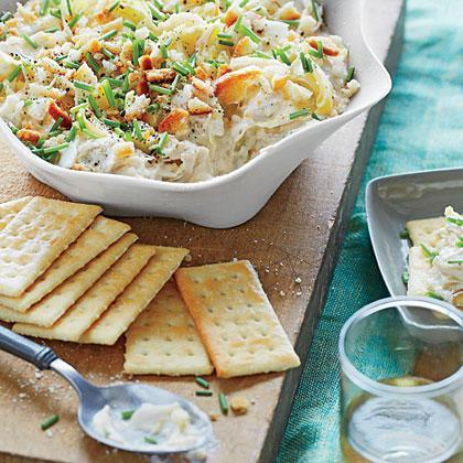 """<p><strong>Recipe:</strong> <a href=""""https://www.southernliving.com/recipes/artichoke-and-crab-meat-dip-recipe"""" rel=""""nofollow noopener"""" target=""""_blank"""" data-ylk=""""slk:Artichoke and Crab Meat Dip"""" class=""""link rapid-noclick-resp"""">Artichoke and Crab Meat Dip</a></p> <p>Like all good recipes, this dip starts with a delicious base of cream cheese mixed with Parmesan cheese. The artichokes and crab meat make an unforgettable pair.</p>"""