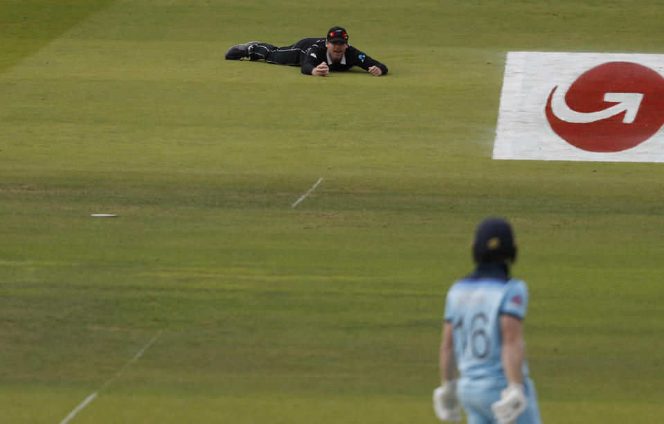 Ferguson, top, looks up after taking a catch to dismiss England's captain Morgan (AP Photo/Alastair Grant)