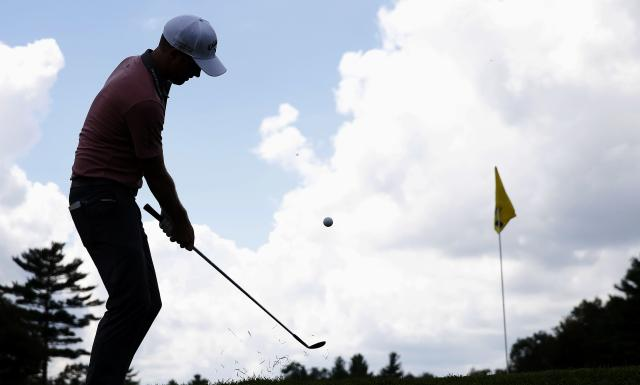 Chris Kirk chips to the second green during the final round of the Deutsche Bank Championship golf tournament in Norton, Mass., Monday, Sept. 1, 2014. (AP Photo/Michael Dwyer)