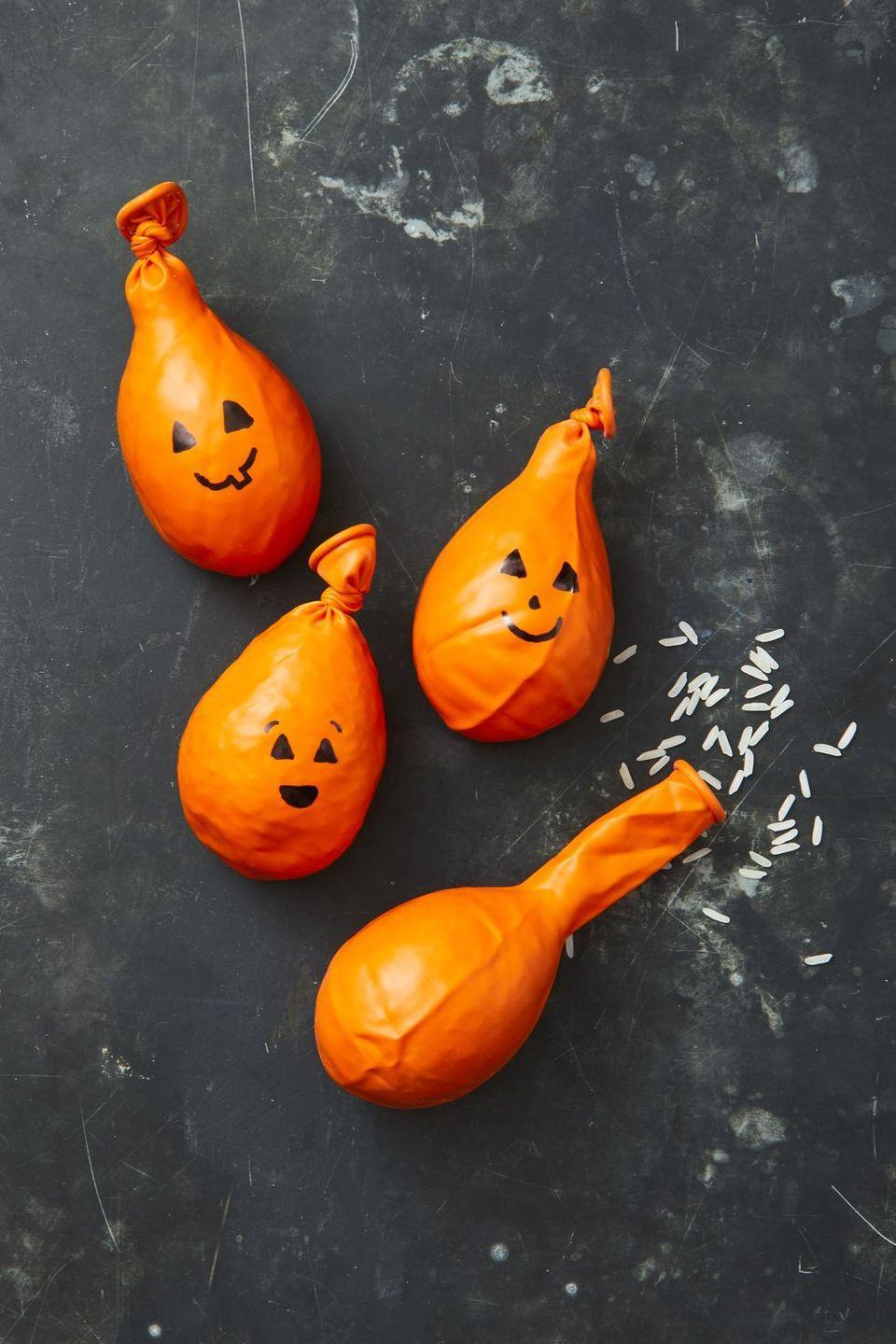 "<p><span>Don't worry: These rice-filled DIY pumpkin stress balls are super easy to make. Just fill up orange balloons with rice and draw on a cute (or creepy) face.</span> </p><p><a class=""link rapid-noclick-resp"" href=""https://www.amazon.com/Prextex-Balloons-Matching-Decoration-Weddings/dp/B07V9ZXF2X/?tag=syn-yahoo-20&ascsubtag=%5Bartid%7C10055.g.22062770%5Bsrc%7Cyahoo-us"" rel=""nofollow noopener"" target=""_blank"" data-ylk=""slk:SHOP ORANGE BALLOONS"">SHOP ORANGE BALLOONS</a></p>"