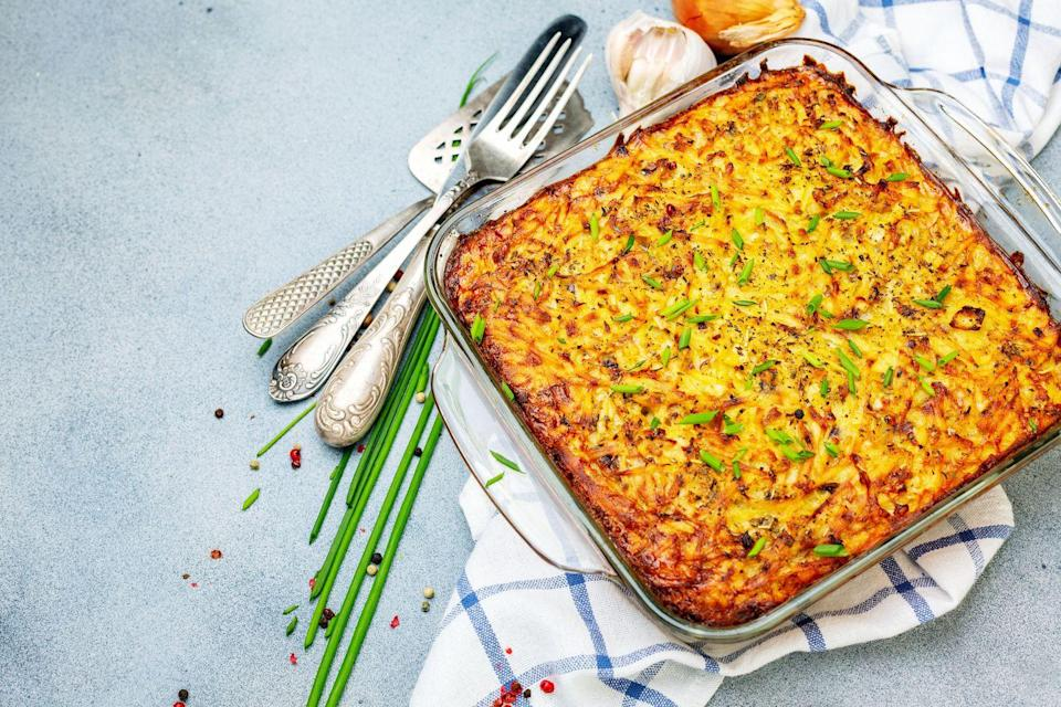 """<p>Crispy on top and fluffy inside, this steaming hot kugel will be the star of your seder.</p><p><em><a href=""""https://www.womansday.com/food-recipes/food-drinks/recipes/a30055/potato-kugel-recipe/"""" rel=""""nofollow noopener"""" target=""""_blank"""" data-ylk=""""slk:Get the recipe from Woman's Day »"""" class=""""link rapid-noclick-resp"""">Get the recipe from Woman's Day »</a></em></p>"""