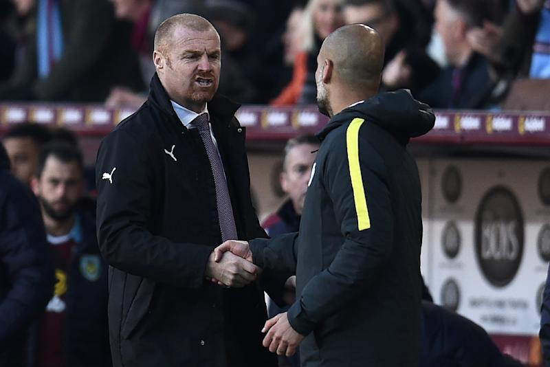 """Burnley manager Sean Dyche (L) said his team's plan had been to make life """"as awkward and tough as possible"""" for Manchester City (AFP Photo/Oli Scarff                        )"""
