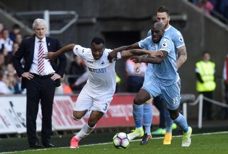 Britain Soccer Football - Swansea City v Stoke City - Premier League - Liberty Stadium - 22/4/17 Swansea City's Jordan Ayew in action with Stoke City's Bruno Martins Indi Reuters / Rebecca Naden Livepic