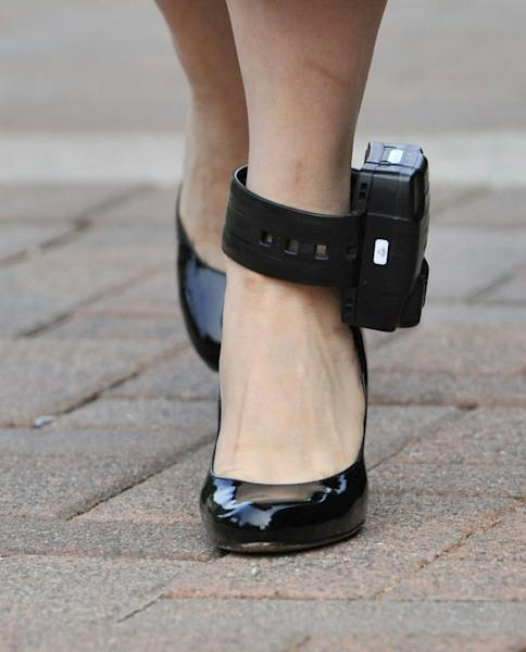 Huawei CFO Meng Wanzhou left her Vancouver home where she is being detained for a court hearing in early October wearing an ankle monitor (AFP Photo/Don MacKinnon)