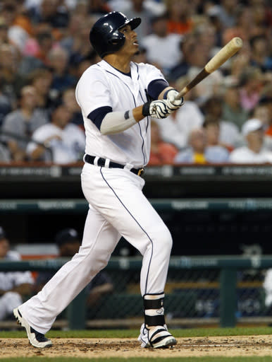 Detroit Tigers' Victor Martinez doubles to center field to drive in Austin Jackson and Andy Dirks in the third inning of a baseball game against the Cleveland Indians, Friday, Aug. 30, 2013, in Detroit. (AP Photo/Duane Burleson)