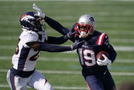New England Patriots wide receiver Isaiah Zuber (19) tries to elude Denver Broncos cornerback Michael Ojemudia, left, in the first half of an NFL football game, Sunday, Oct. 18, 2020, in Foxborough, Mass. (AP Photo/Charles Krupa)