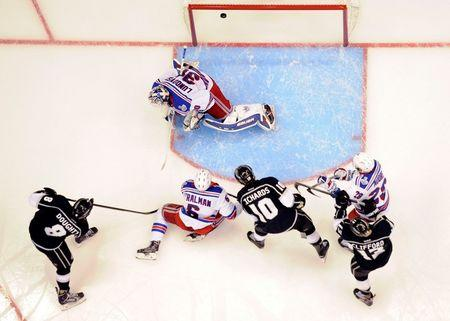 Jun 4, 2014; Los Angeles, CA, USA; Los Angeles Kings defenseman Drew Doughty (8) scores a goal against New York Rangers goalie Henrik Lundqvist (30) during the first period in game one of the 2014 Stanley Cup Final at Staples Center. Mandatory Credit: Richard Mackson-USA TODAY Sports