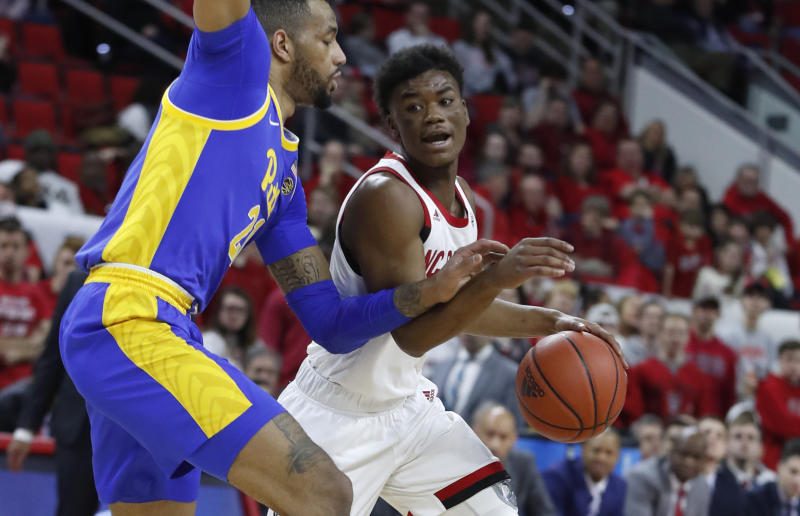 North Carolina State's Markell Johnson (11) drives past Pittsburgh's Terrell Brown (21) during the first half of an NCAA college basketball game at PNC Arena in Raleigh, N.C., Saturday, Feb. 29, 2020. (Ethan Hyman/The News & Observer via AP)