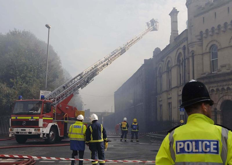 Firemen damping down a warehouse belonging to Aardman Animations in Bristol following a fire. (Photo by Barry Batchelor - PA Images/PA Images via Getty Images)
