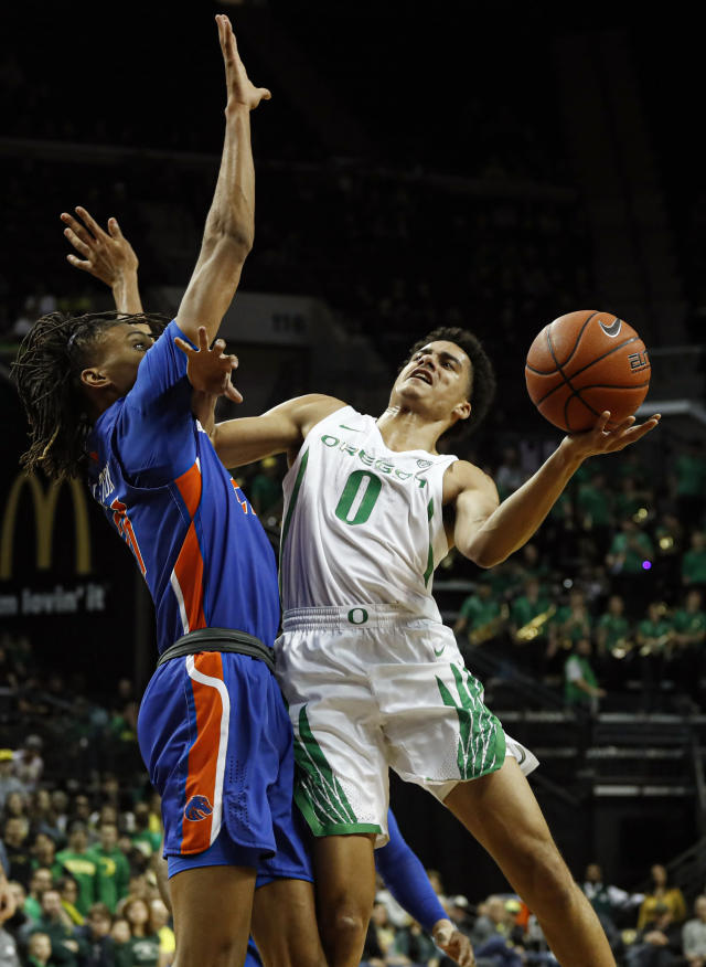 Oregon guard Will Richardson (0), shoots against Boise State guard Derrick Alston (21), in an NCAA college basketball game Saturday, Nov. 9, 2019, in Eugene, Ore. (AP Photo/Thomas Boyd)