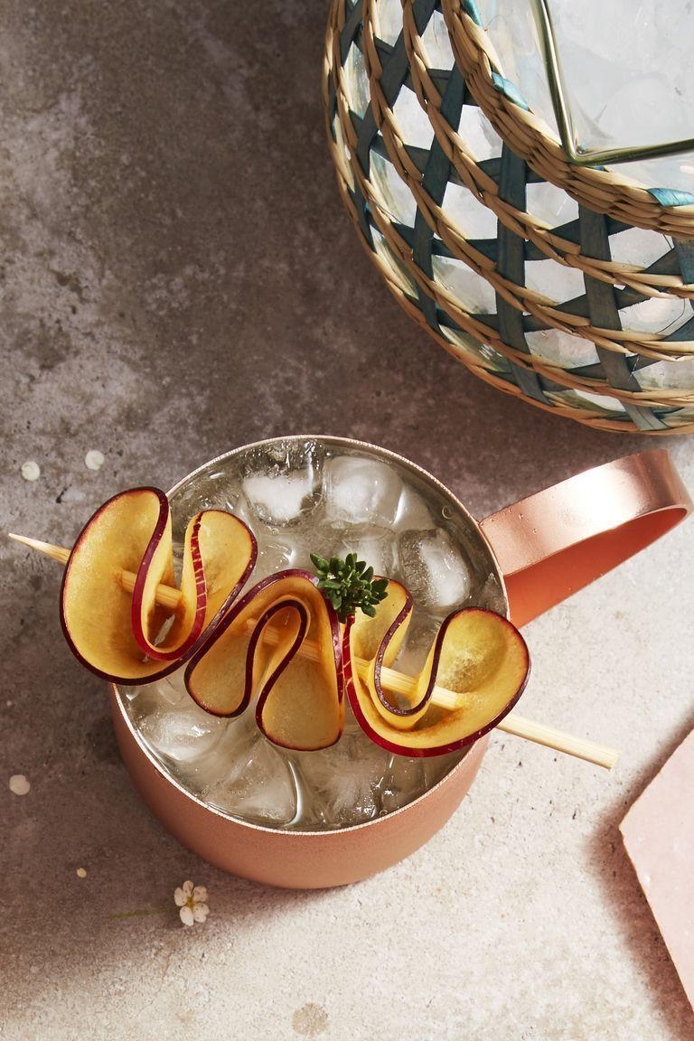 """<p>Thyme to party with a plum Moscow Mule! Give the classic a twist with a touch of plum. Garnish with a bit of the fruit and fragrant herb for a visual delight.<br><br><em><a href=""""https://www.goodhousekeeping.com/food-recipes/a22576820/thyme-plum-moscow-mules-recipe/"""" rel=""""nofollow noopener"""" target=""""_blank"""" data-ylk=""""slk:Get the recipe for Thyme Plum Moscow Mule »"""" class=""""link rapid-noclick-resp"""">Get the recipe for Thyme Plum Moscow Mule »</a></em><br></p>"""