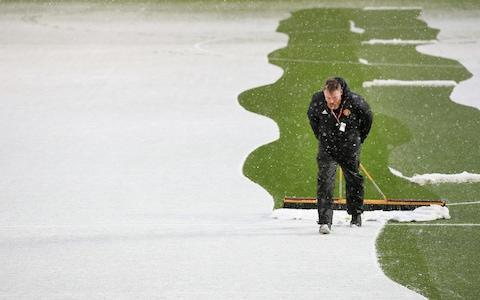 Man Utd clearing the pitch - Credit: OFFSIDE