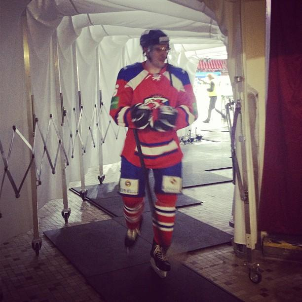 Prague Lions player walking down tunnel during KHL game. (#NickInEurope)