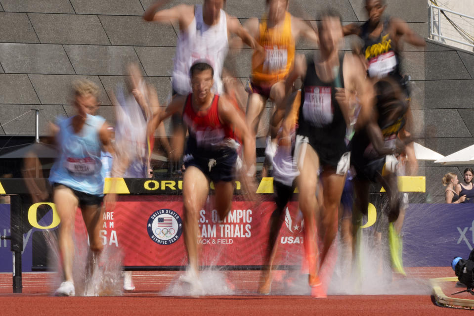 Runners compete during first heat of the men's 3000-meter steeplechase at the U.S. Olympic Track and Field Trials Monday, June 21, 2021, in Eugene, Ore. (AP Photo/Charlie Riedel)