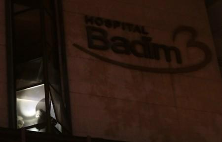 Firefighters work after a fire hit the Badim Hospital in Rio de Janeiro