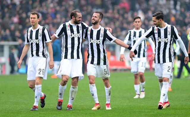 Soccer Football - Serie A - Torino vs Juventus - Stadio Olimpico Grande Torino, Turin, Italy - February 18, 2018 Juventus' Giorgio Chiellini, Miralem Pjanic and team mates celebrate in front of their fans at the end of the match REUTERS/Massimo Pinca