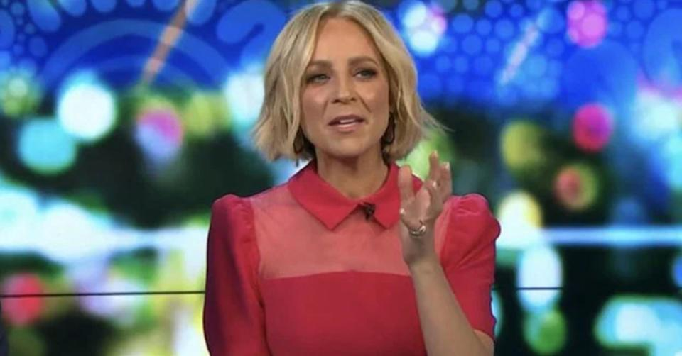 The Project host Carrie Bickmore wearing a pink collared dress on set