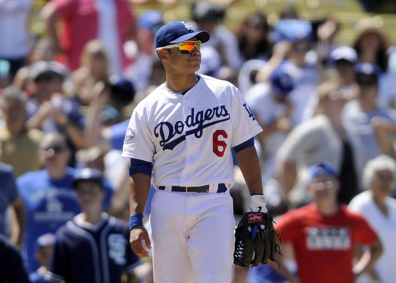 Los Angeles Dodgers second baseman Jerry Hairston Jr. reacts after committing his second throwing error , which allowed two runs to score in the seventh inning of a baseball game against the San Diego Padres, Sunday, July 15, 2012, in Los Angeles. (AP Photo/Gus Ruelas)