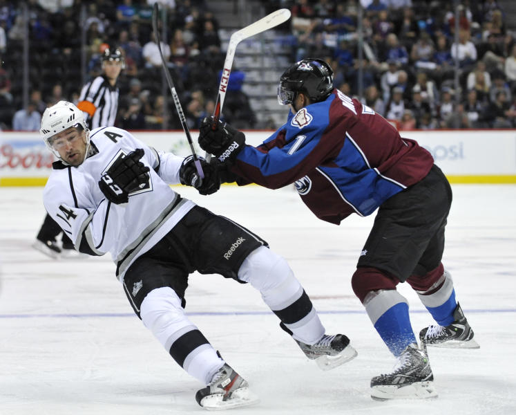 Colorado Avalanche center John Mitchell (7) knocks Los Angeles Kings right wing Justin Williams (14) off his skates during the second period of a preseason NHL hockey game on Friday, Sept. 20, 2013, in Denver. (AP Photo/Jack Dempsey)