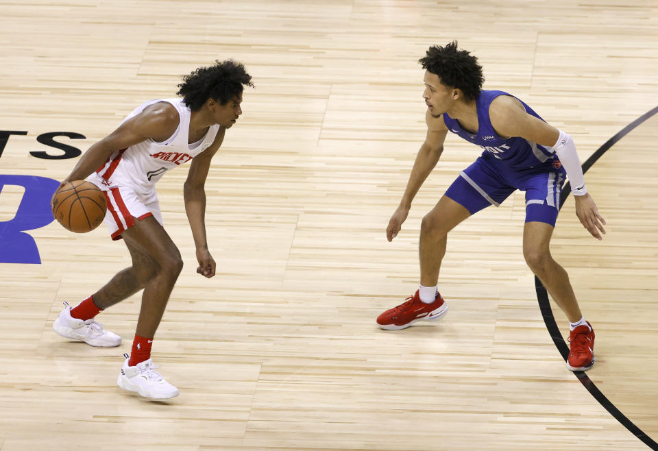 Houston's Jalen Green is guarded by Detroit's Cade Cunningham during a matchup of the top two draft picks in a summer league game at the Thomas & Mack Center in Las Vegas on Aug. 10, 2021. The Rockets defeated the Pistons 111-91. (Ethan Miller/Getty Images)