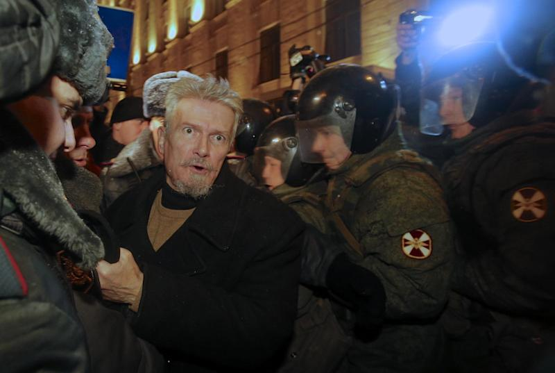 Russian police detain opposition leader Edouard Limonov, center left, during an unsanctioned rally in downtown Moscow, Russia, Monday, Dec. 31, 2012. The Russian opposition protests on the 31st of each month are a nod to the 31st article of the Russian constitution, which guarantees the right of assembly. (AP Photo/Alexander Zemlianichenko)