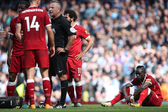 Sadio Mane was dejected as Liverpool players protested Mane's red card. (Getty)