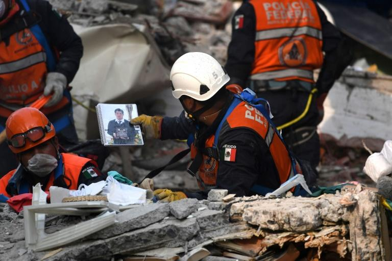 A rescue worker recovers objects and belongings that can help identify quake victims during the search for survivors and bodies in Mexico City