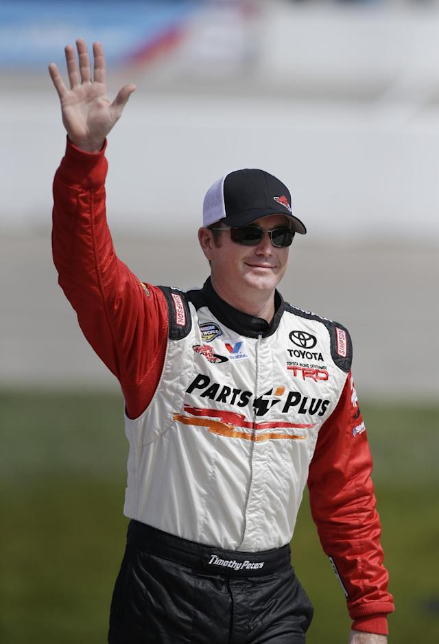 Timothy Peters is introduced before the start of the NASCAR Truck Series auto race, Sunday, Sept. 8, 2013, at Iowa Speedway in Newton, Iowa. (AP Photo/Charlie Neibergall)