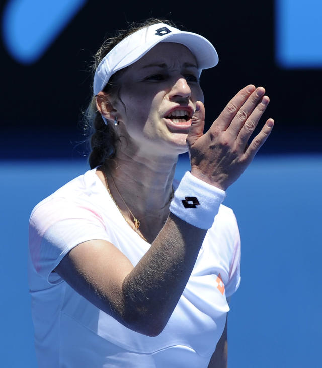 Ekaterina Makarova of Russia reacts during her first round match against Venus Williams of the U.S. at the Australian Open tennis championship in Melbourne, Australia, Monday, Jan. 13, 2014. (AP Photo/Andrew Brownbill)