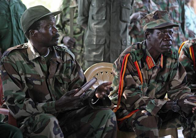 FILE - In this Nov. 12, 2006 file photo the leader of the Lord's Resistance Army, Joseph Kony, left, and his deputy Vincent Otti sit inside a tent at Ri-Kwamba in Southern Sudan. A video by the advocacy group Invisible Children about the atrocities carried out by jungle militia leader Joseph Kony's Lord's Resistance Army is rocketing into viral video territory and is racking up millions of page views seemingly by the hour. (AP Photo/Stuart Price, File, Pool)