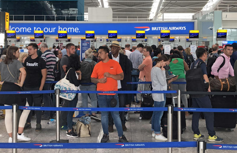 Queues in Terminal 5 at Heathrow airport as the UK's biggest airport has apologised after extreme weather conditions across Europe caused flight cancellations and delays. (Photo by Steve Parsons/PA Images via Getty Images)