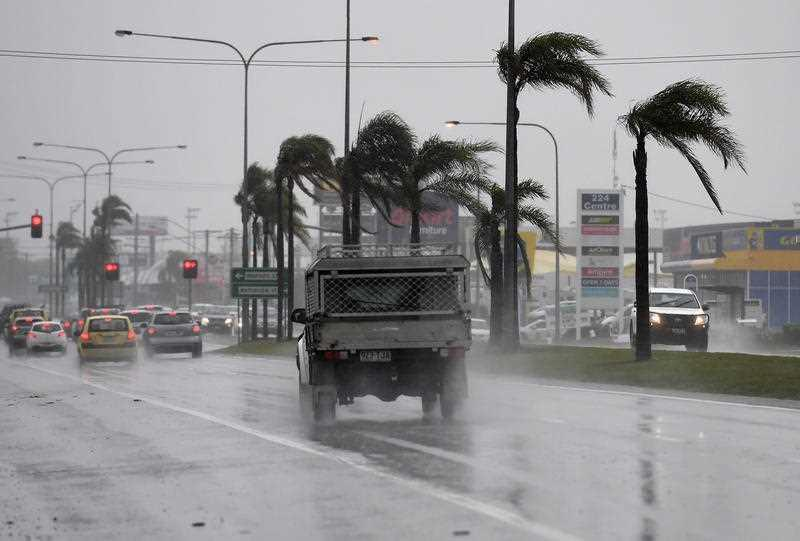 Drivers endure heavy rain and strong winds on Queensland's Sunshine Coast in 2017.