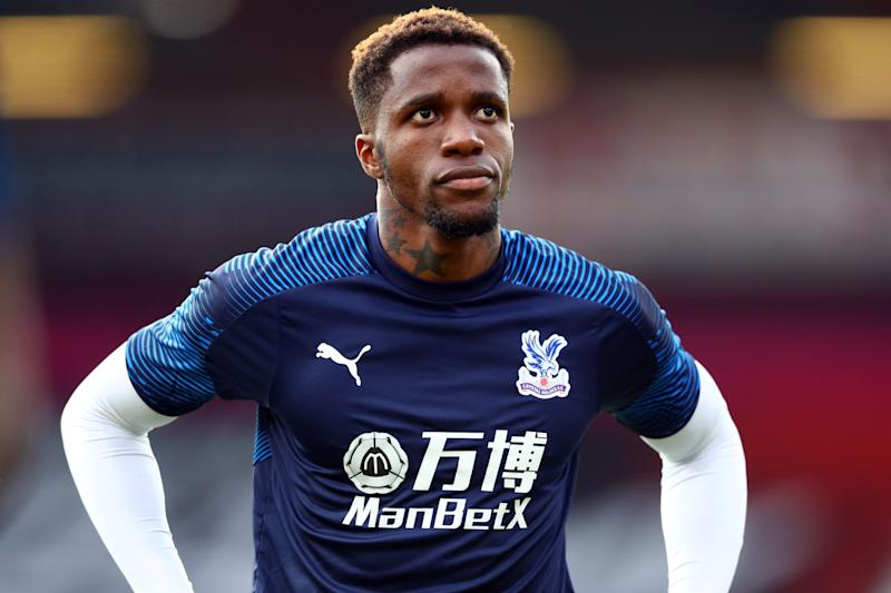 Wilfried Zaha received racist messages on Instagram, and the police have arrested a 12-year-old boy who may be responsible. (Photo by MICHAEL STEELE/POOL/AFP via Getty Images)