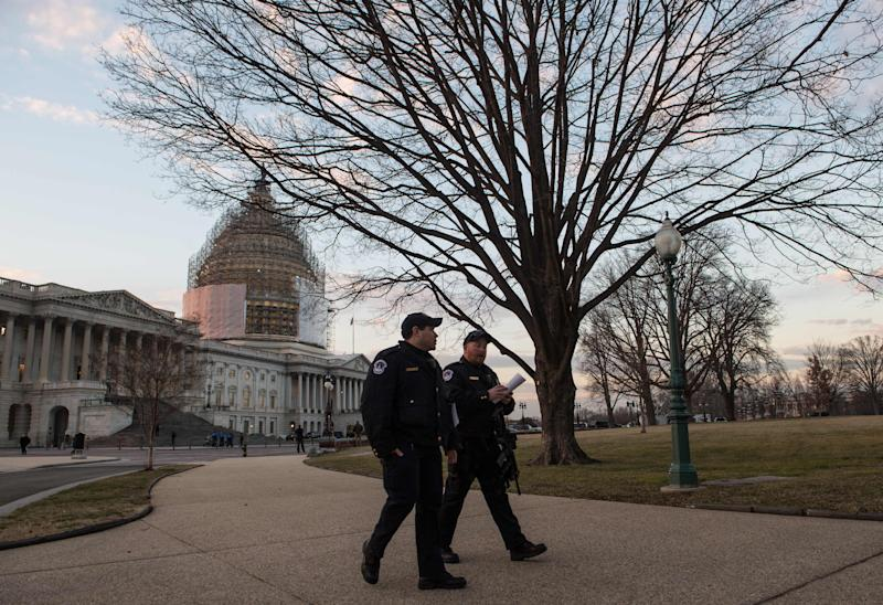 Police patrol on Capitol Hill in Washington, DC, before US President Barack Obama delivers the State of the Union address (AFP Photo/Nicholas Kamm)