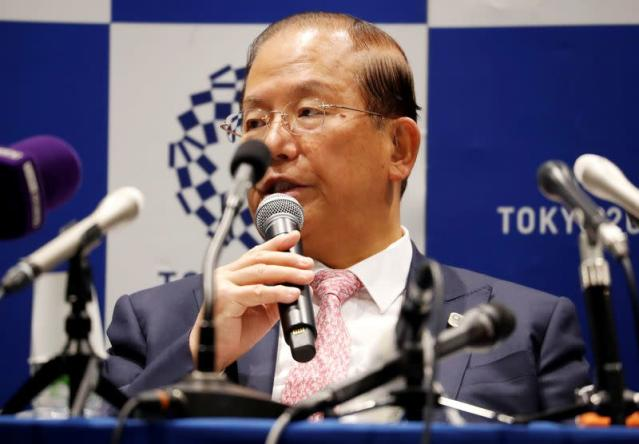 FILE PHOTO: Toshiro Muto, Tokyo 2020 Organizing Committee Chief Executive Officer, attends a news conference after Tokyo 2020 Executive Board Meeting in Tokyo