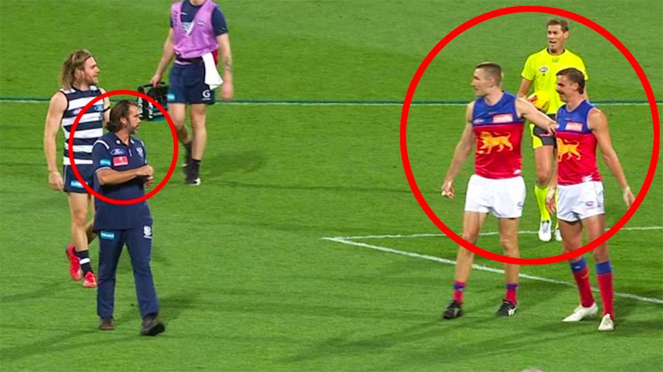 Geelong coach Chris Scott is seen here arguing with Brisbane Lions players.