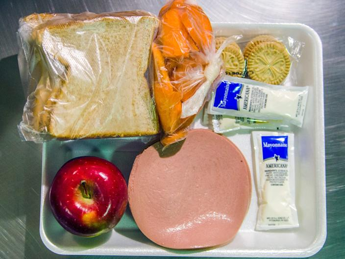 ORANGE, CA - MARCH 14: An example of a lunch that include bologna, two pieces of bread, mayonnaise, an apple, carrots and crackers at the Theo Lacy Facility in Orange, California, on Tuesday, March 14, 2017. Detainees in Module I at the Theo Lacy Facility. The Orange County sheriff conducted a media tour of the jail that included the intake area, the kitchen, an isolation unit and a modular holding area. (Photo by Jeff Gritchen/Digital First Media/Orange County Register via Getty Images)