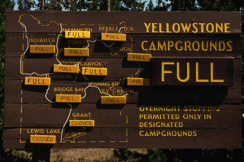 The Yellowstone Campground sign indicating all campgrounds are full at the entrance to Yellowstone National Park, Wyoming. (Photo: Getty Images)