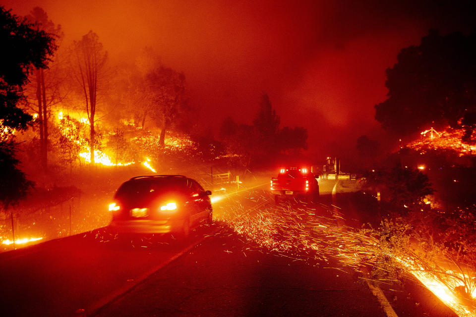Embers fly across a roadway as the Kincade Fire burns through the Jimtown community of Sonoma County, Calif., on Thursday, Oct. 24, 2019. (Photo: Noah Berger/AP)