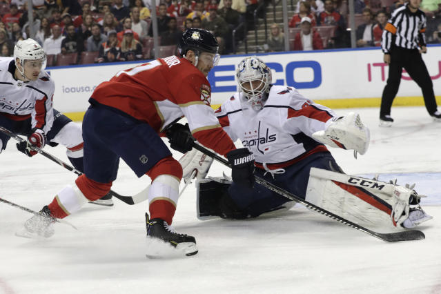 Washington Capitals goaltender Braden Holtby, front right, stops a shot by Florida Panthers center Colton Sceviour, front left, during the first period of an an NHL hockey game, Thursday, Nov. 7, 2019, in Sunrise, Fla. (AP Photo/Lynne Sladky)