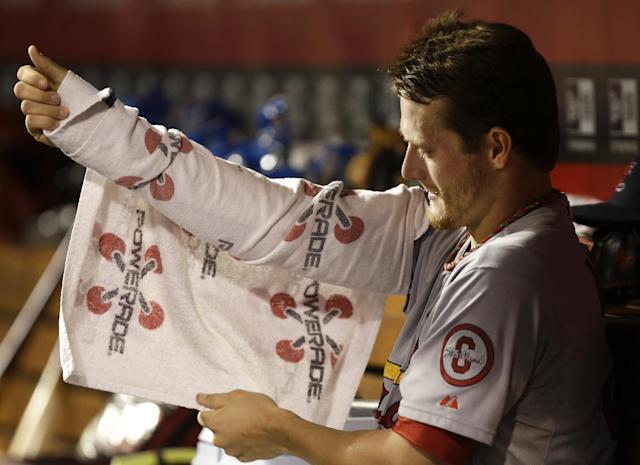 St. Louis Cardinals starting pitcher Shelby Miller wraps his pitching arm in the dugout during the fourth inning of a baseball game against the Cincinnati Reds, Wednesday, Sept. 4, 2013, in Cincinnati. (AP Photo/Al Behrman)