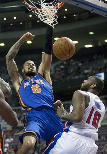 New York Knicks' Tyson Chandler (6) celebrates after dunking over Detroit Pistons' Greg Monroe (10) in the first half of an NBA basketball game Saturday, Jan. 7, 2012, in Auburn Hills, Mich. (AP Photo/Duane Burleson)