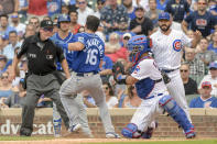 Kansas City Royals' Andrew Benintendi (16) dodges the tag by Chicago Cubs catcher Robinson Chirinos (29) to score but not after a replay call reversal during the fifth inning of a baseball game, Saturday, Aug. 21, 2021, in Chicago. (AP Photo/Mark Black)