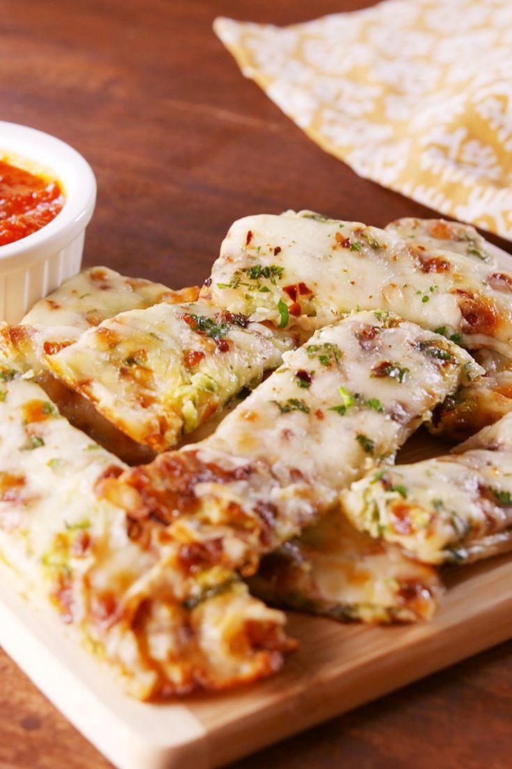 """<p>Love cheese but hate carbs?</p><p>Get the recipe from <a href=""""https://patty-delish.hearstapps.com/cooking/recipe-ideas/recipes/a54806/zucchini-cheesy-bread-recipe/"""" rel=""""nofollow noopener"""" target=""""_blank"""" data-ylk=""""slk:Delish"""" class=""""link rapid-noclick-resp"""">Delish</a>.</p>"""