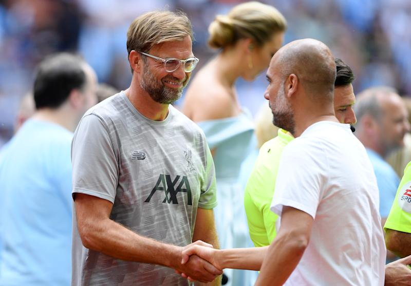 Jurgen Klopp shakes hands with Pep Guardiola before the start of the match. (Credit: Getty Images)