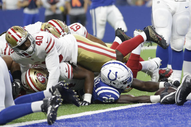 Indianapolis Colts running back Christine Michael (38) reaches in to score under San Francisco 49ers cornerback D.J. Reed (40) in the second half of an NFL preseason football game in Indianapolis, Saturday, Aug. 25, 2018. (AP Photo/AJ Mast)