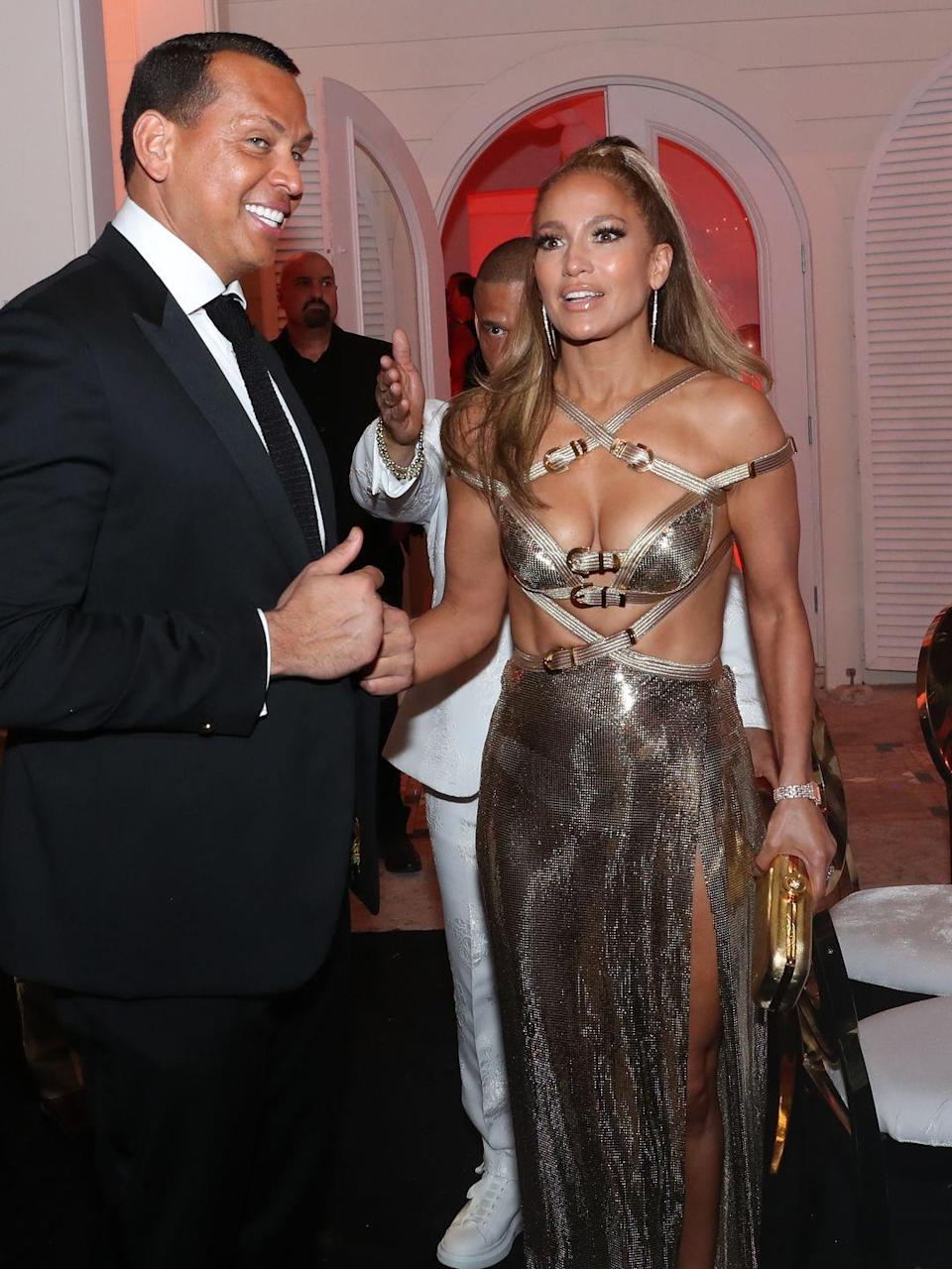 """<p>J.Lo celebrated her <a href=""""http://www.cosmopolitan.com/uk/fashion/celebrity/a28504507/jennifer-lopez-naked-birthday-dress/"""" rel=""""nofollow noopener"""" target=""""_blank"""" data-ylk=""""slk:50th birthday"""" class=""""link rapid-noclick-resp"""">50th birthday</a> wearing the sexiest gold strap dress, with buckle details and a generous amount of sexy cut-outs. Alex Rodriguez was, of course, present for the occasion, and holy crap, I can't get over how fierce Jen looks.</p>"""