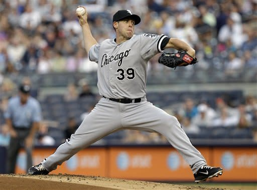 Chicago White Sox relief pitcher Dylan Axelrod delivers in the first inning against the New York Yankees during a baseball game at Yankee Stadium in New York, Thursday, June 28, 2012. (AP Photo/Kathy Willens)