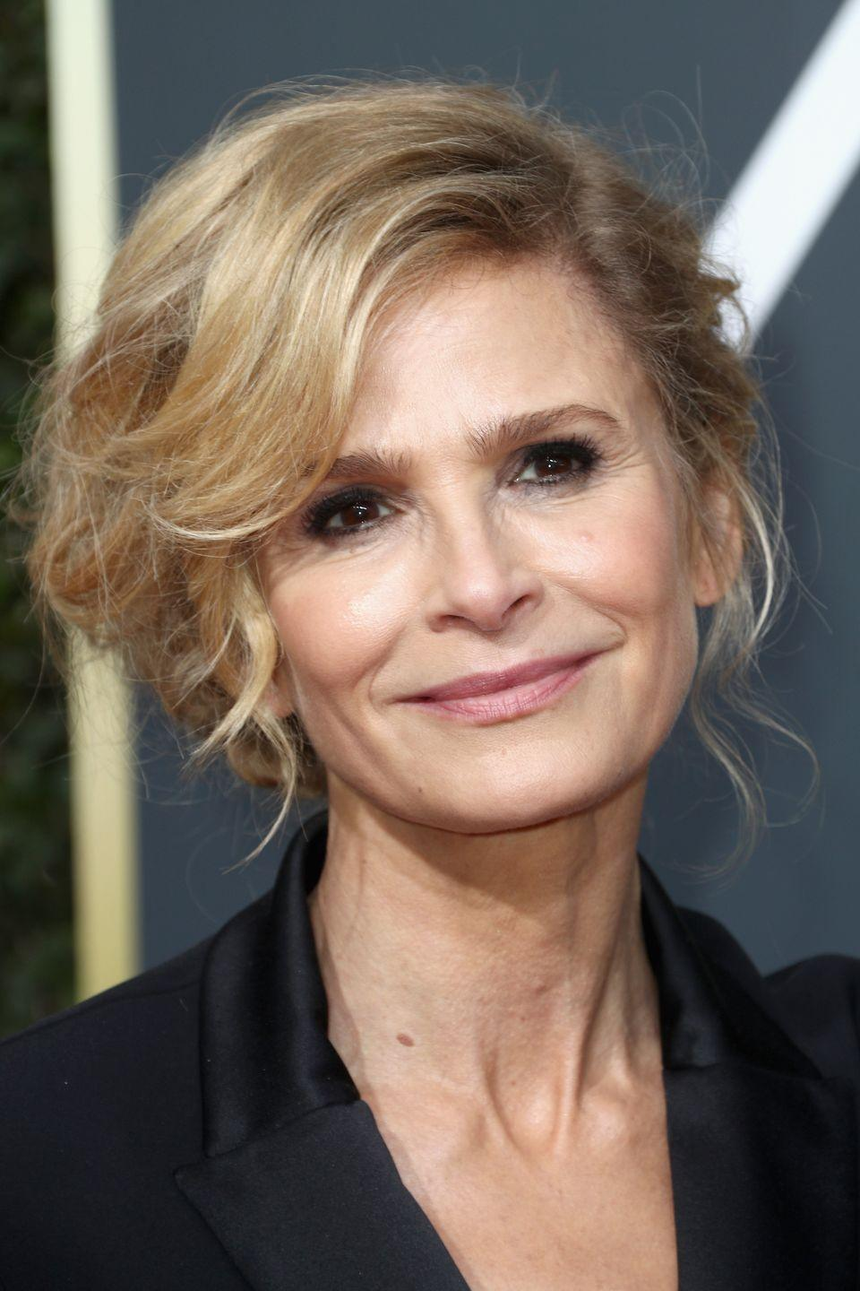 """<p>Kyra Sedgwick's full side-swept bangs are a flattering way to prevent an <a href=""""https://www.goodhousekeeping.com/beauty/hair/tips/g1800/celebrity-hairstyles-updo/"""" rel=""""nofollow noopener"""" target=""""_blank"""" data-ylk=""""slk:updo"""" class=""""link rapid-noclick-resp"""">updo</a> from looking severe.</p>"""